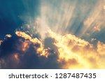golden sunbeam coming through... | Shutterstock . vector #1287487435