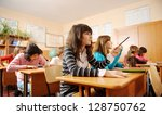 schoolchildren during lesson in ... | Shutterstock . vector #128750762