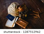 passport a long with binoculars ... | Shutterstock . vector #1287512962