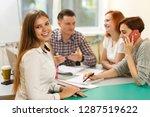 side view of attractive teacher ... | Shutterstock . vector #1287519622