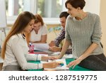 side view of girls discussing... | Shutterstock . vector #1287519775