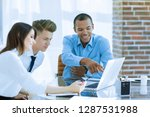 employees talking to a customer ... | Shutterstock . vector #1287531988
