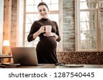 favourite drink. nice pregnant... | Shutterstock . vector #1287540445