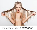 Portrait of beautiful aggressive young woman with creative braid hairdo - stock photo