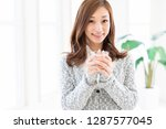 young attractive asian woman... | Shutterstock . vector #1287577045