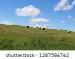 view of hay bales in a field on ... | Shutterstock . vector #1287586762