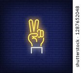 peace neon sign. glowing hand... | Shutterstock .eps vector #1287652048