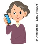 a senior woman is calling with...   Shutterstock .eps vector #1287695005
