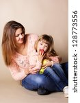 young mother with her little... | Shutterstock . vector #128773556