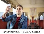 handsome guy traveling on a... | Shutterstock . vector #1287753865