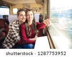 young couple traveling on a... | Shutterstock . vector #1287753952
