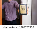 debt collector   bailiff at the ... | Shutterstock . vector #1287757198