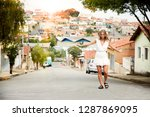 carefree woman wearing white in ... | Shutterstock . vector #1287869095