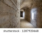 curved stone tunnel with sun... | Shutterstock . vector #1287920668