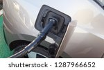 power supply plugged into an... | Shutterstock . vector #1287966652