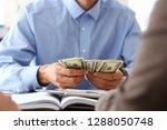 the businessman considers cash...   Shutterstock . vector #1288050748