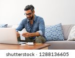 mature casual man using laptop... | Shutterstock . vector #1288136605