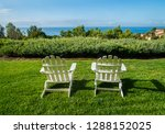 group of two white adirondack... | Shutterstock . vector #1288152025