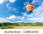 hot air balloon over the field | Shutterstock . vector #128816302