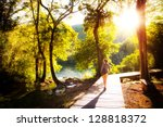 beautiful young woman walks in... | Shutterstock . vector #128818372