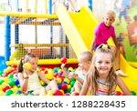 happy small girl in elementary...   Shutterstock . vector #1288228435