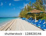 Lounge chairs on a white sand beach, Coco Cay, Bahamas - stock photo