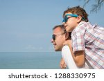 father and son playing on the... | Shutterstock . vector #1288330975