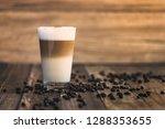 a glass of organic caffe latte...   Shutterstock . vector #1288353655