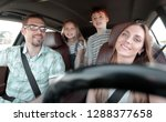 young parents go in the car | Shutterstock . vector #1288377658