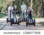 happy family riding electric... | Shutterstock . vector #1288377838