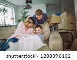 happy family with cardboard... | Shutterstock . vector #1288396102