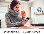 woman wearing grey sweater... | Shutterstock . vector #1288443925