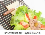 Vegetable salad with fork and knife - stock photo