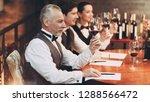 three sommeliers assess taste... | Shutterstock . vector #1288566472