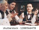 three sommeliers assess taste... | Shutterstock . vector #1288566478