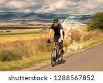gorgeous biker in the nature...   Shutterstock . vector #1288567852