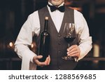 experienced sommelier in bow... | Shutterstock . vector #1288569685