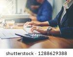 businesswoman analyzing data... | Shutterstock . vector #1288629388