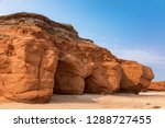 The Red Cliffs And Beach Of ...