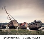 old wrecked wooden boats at pin ...
