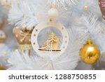 christmas wooden garland on a...   Shutterstock . vector #1288750855