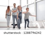 happy family standing in new... | Shutterstock . vector #1288796242