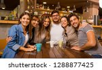 a group of friends looking to... | Shutterstock . vector #1288877425