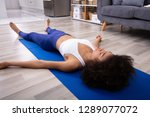 athletic young woman lying on... | Shutterstock . vector #1289077072