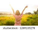 happy woman enjoying nature on... | Shutterstock . vector #1289135278