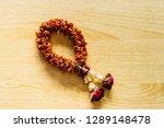 dried flower garland on wooden... | Shutterstock . vector #1289148478