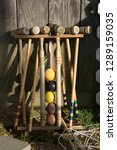 old croquet mallets in a rack... | Shutterstock . vector #1289159035
