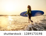 active women with surf board... | Shutterstock . vector #1289173198