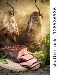 Smoked ham in a traditional rural way - stock photo