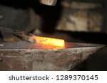 Blacksmith Working Metal With...